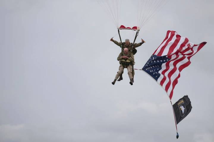 U.S. World War II D-Day veteran Tom Rice, from Coronado, CA, parachutes in a tandem jump into a ...