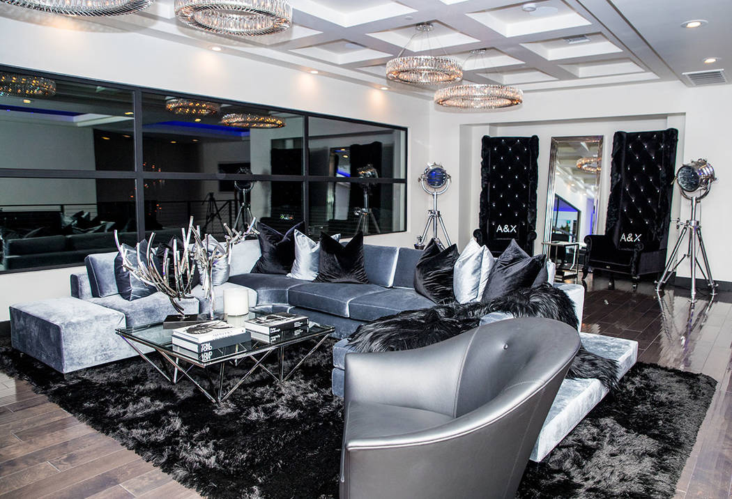 The upstairs loft is done in dramatic black, silver and gray. (Tonya Harvey Real Estate Millions)