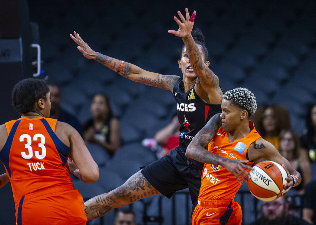 Las Vegas Aces forward Tamera Young (1) attempts to stop a pass attempt by Connecticut Sun guar ...
