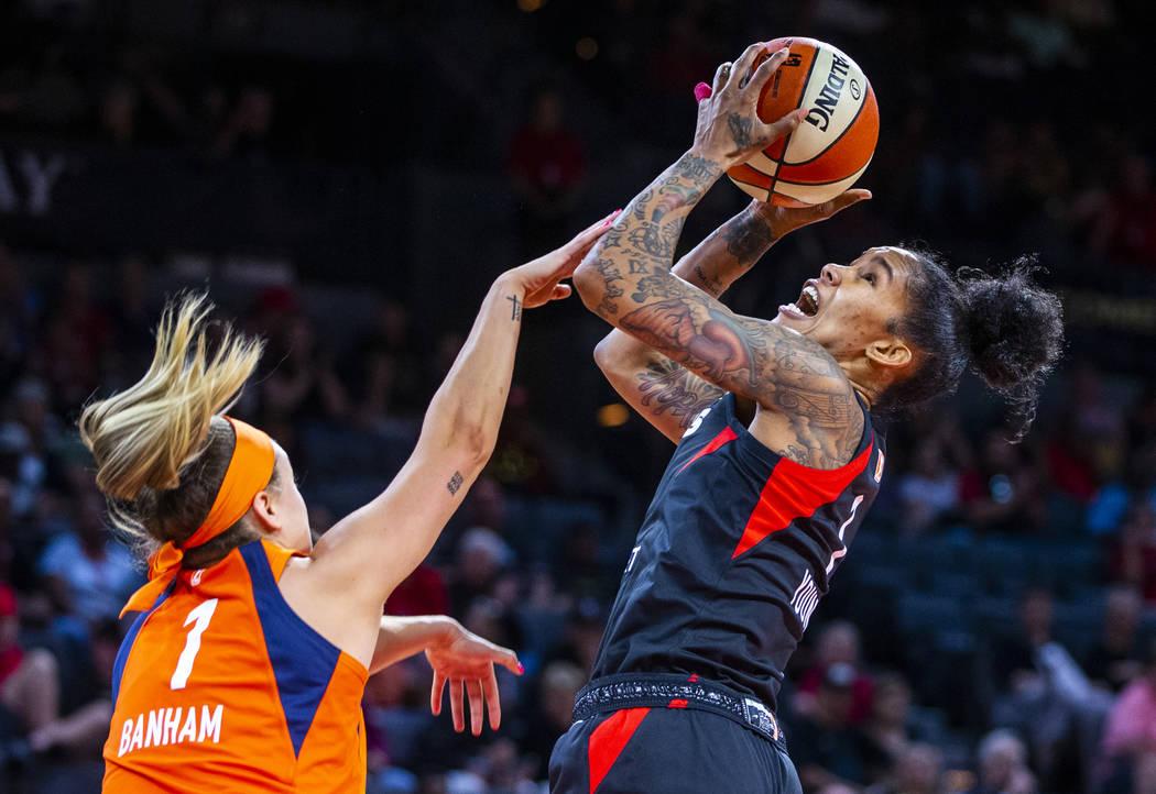 Connecticut Sun guard Rachel Banham (1) fouls Las Vegas Aces forward Tamera Young (1) on a shot ...