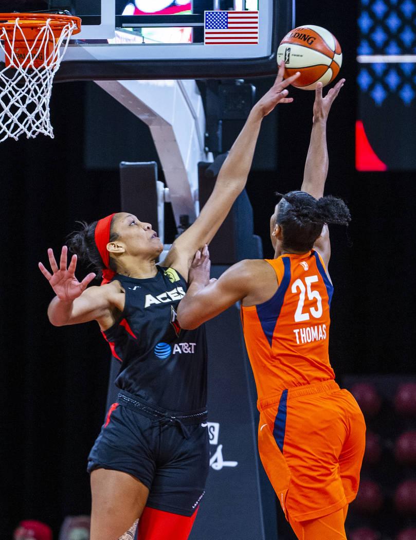 Las Vegas Aces center A'ja Wilson (22) blocks a shot by Connecticut Sun forward Alyssa Thomas ( ...