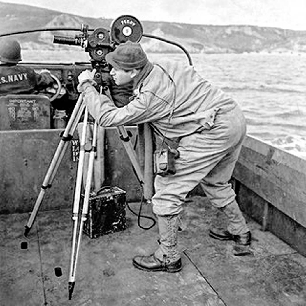 "Army soldier and photographer Burton ""Bud"" Hartman and his camera during D-Day in World War II, ..."