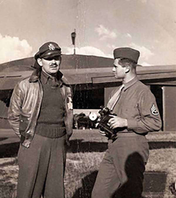 "Young Army soldier Burton ""Bud"" Hartman, right, talks with actor Clark Gable in 1943 ..."