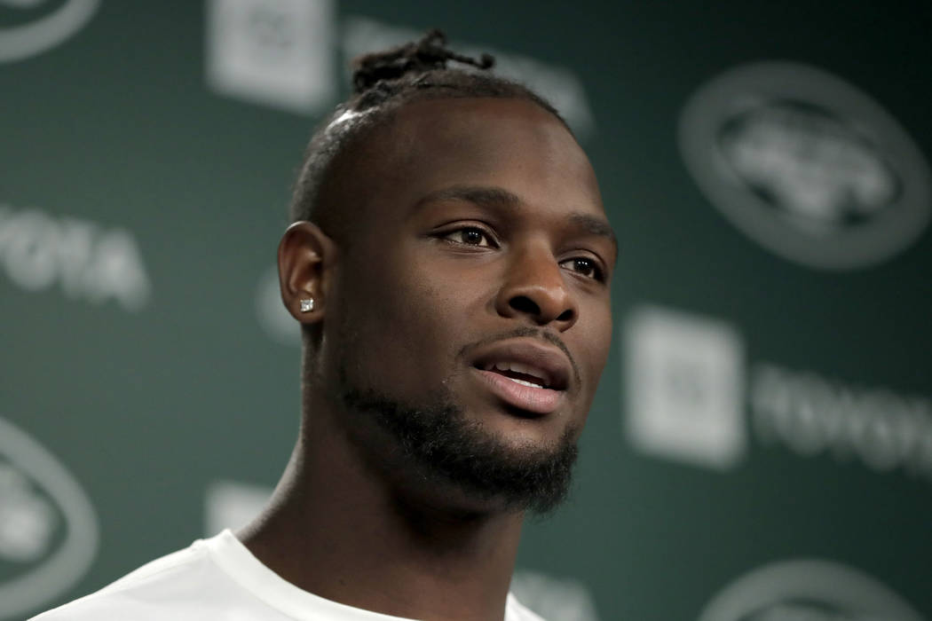 In this Tuesday, June 4, 2019, photo, New York Jets running back Le'Veon Bell speaks to report ...