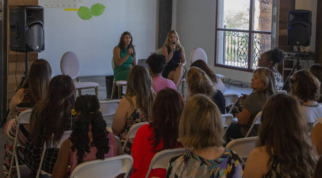 Attendees listen to speakers Paola Armeni, left, and Jaime Kobzelman during the Manifest Summit ...
