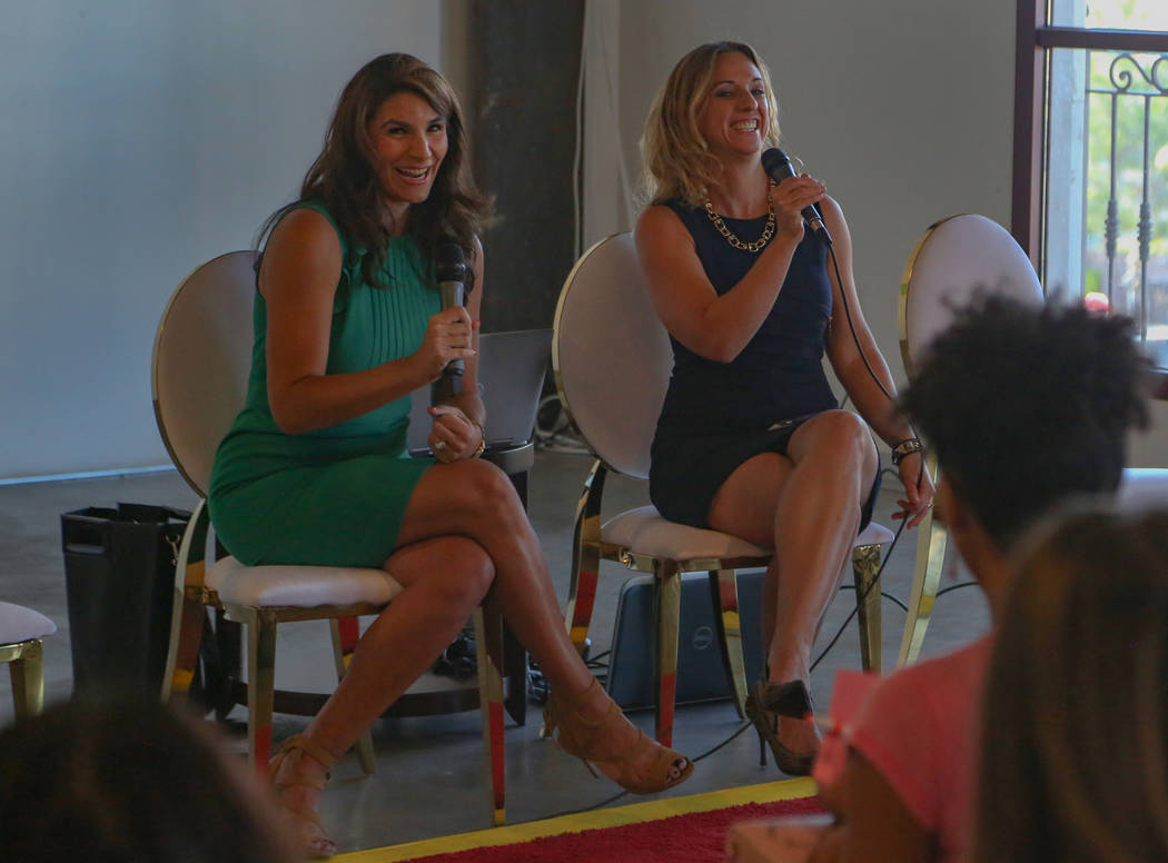 Paola Armeni, left, and Jaime Kobzelman share a laugh while speaking during the Manifest Summit ...