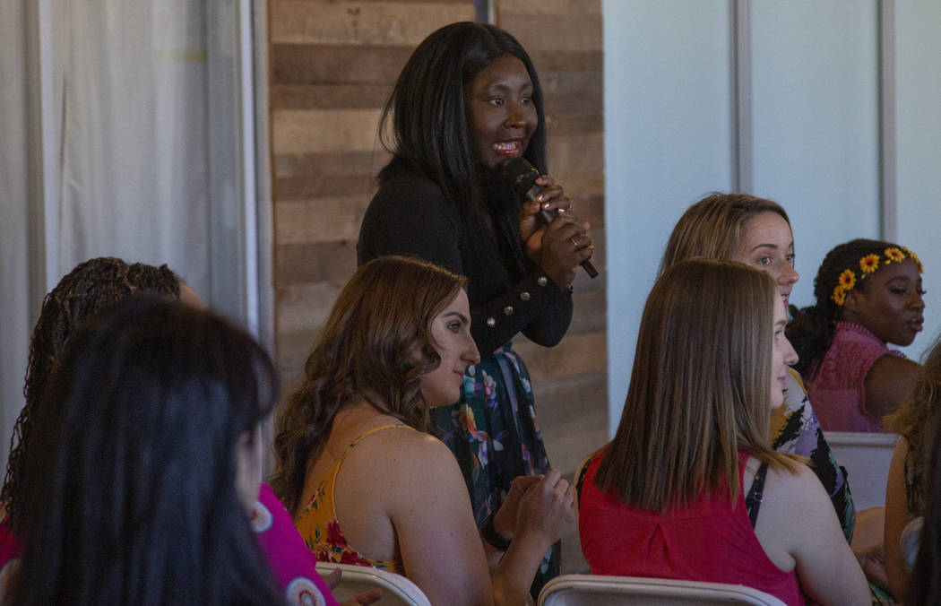Esther Ossei Anto talks to conference goers during the Manifest Summit at Tivoli Village in Las ...