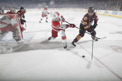 Chicago Wolves right wing Keegan Kolesar (20) and Charlotte Checkers defenseman Roland McKeown ...