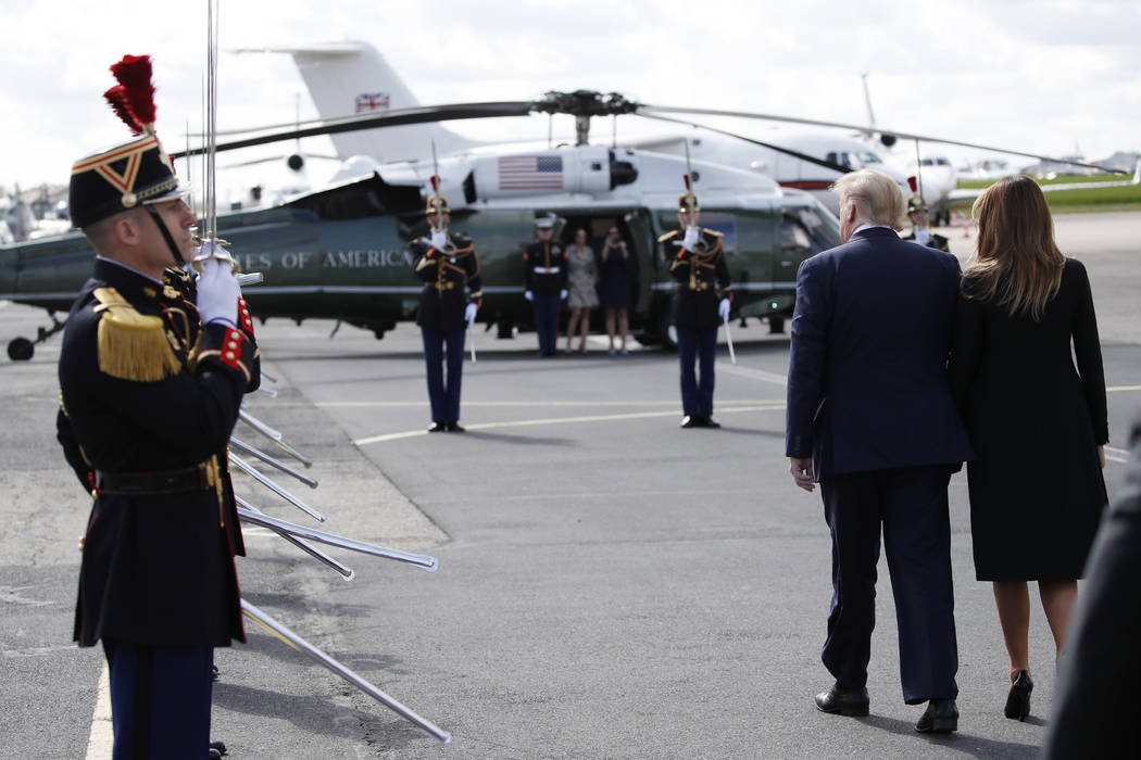 President Donald Trump, with first lady Melania Trump, arrive at Caen Airport, Thursday, June 6 ...
