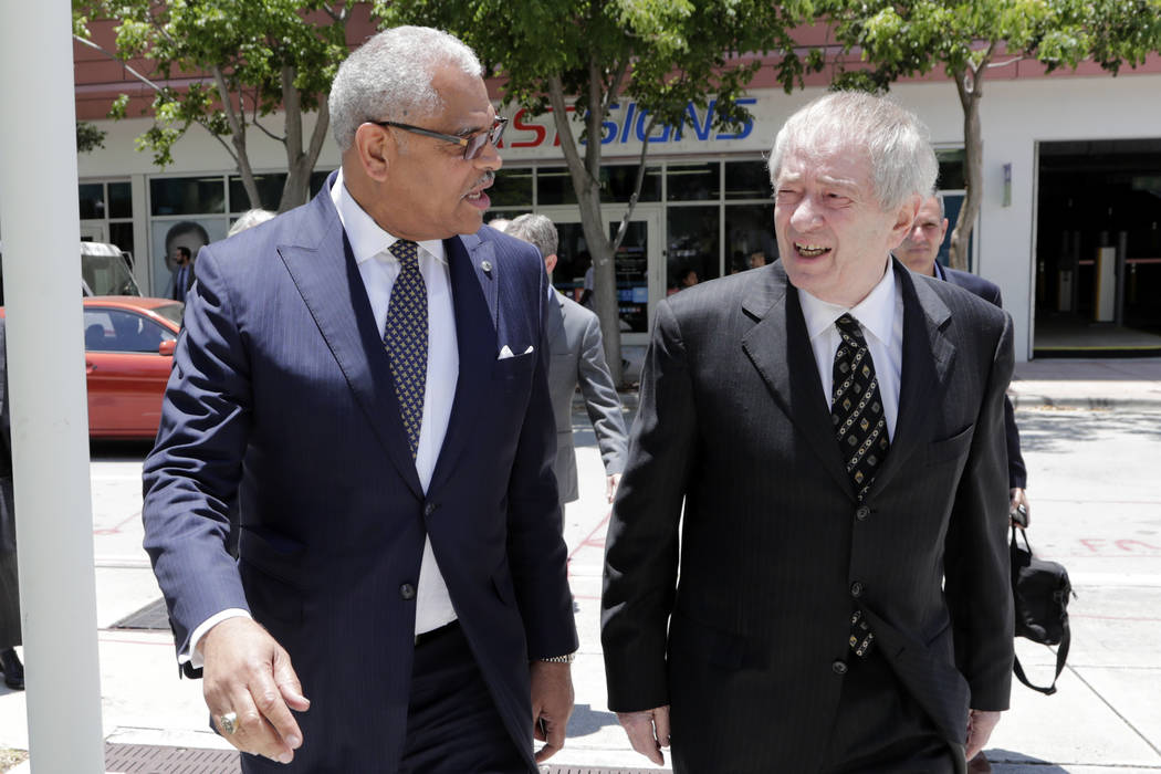 Carnival Corp. President Arnold Donald, left, arrives at federal court, Monday, June 3, 2019, i ...