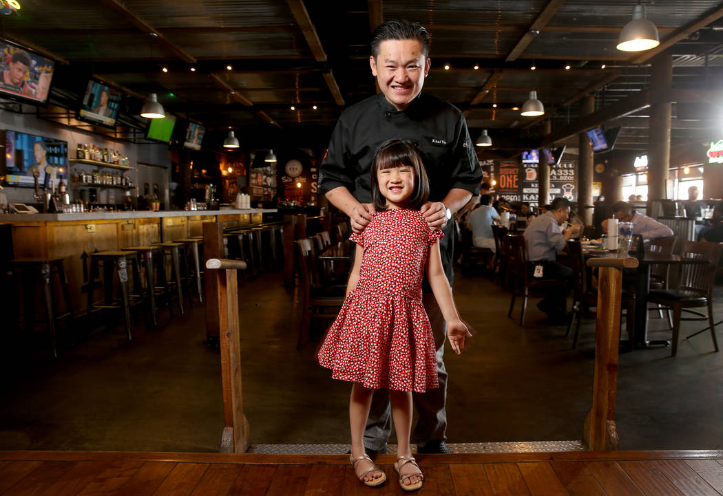 Chef Khai Vu and his daughter, Audrey, 5, at District One Kitchen & Bar in Las Vegas Monday, Ju ...