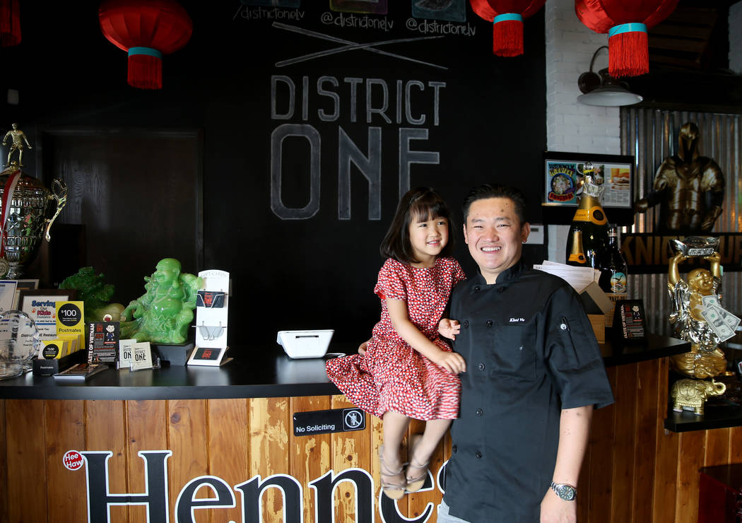 Chef Khai Vu and his daughter, Audrey, 5, at District One Kitchen & Bar in Las Vegas Monday ...