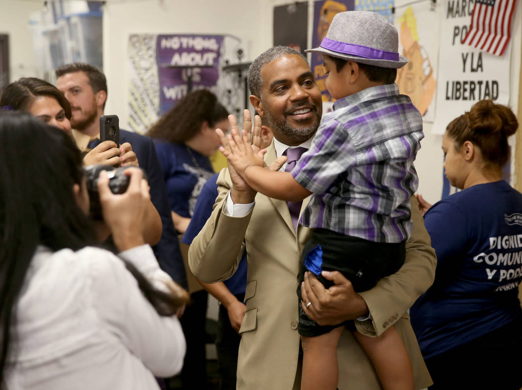 Rep. Steven Horsford, D-Nev., greets Noah Silva, 3, before a news conference in Las Vegas Frida ...