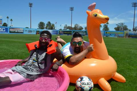 "Hype man Bojo and DJ Ocho promotes the Pitchside Pool Party, highlighting the ""Summer of Soccer ..."