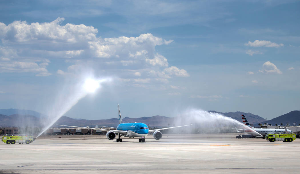 KLM Royal Dutch Airlines flight 635 taxis during a water arch ceremony after arriving at McCarr ...