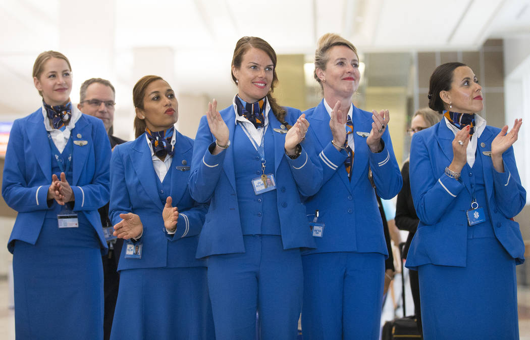 Crew members with KLM Royal Dutch Airlines clap during a ribbon cutting ceremony at McCarran In ...