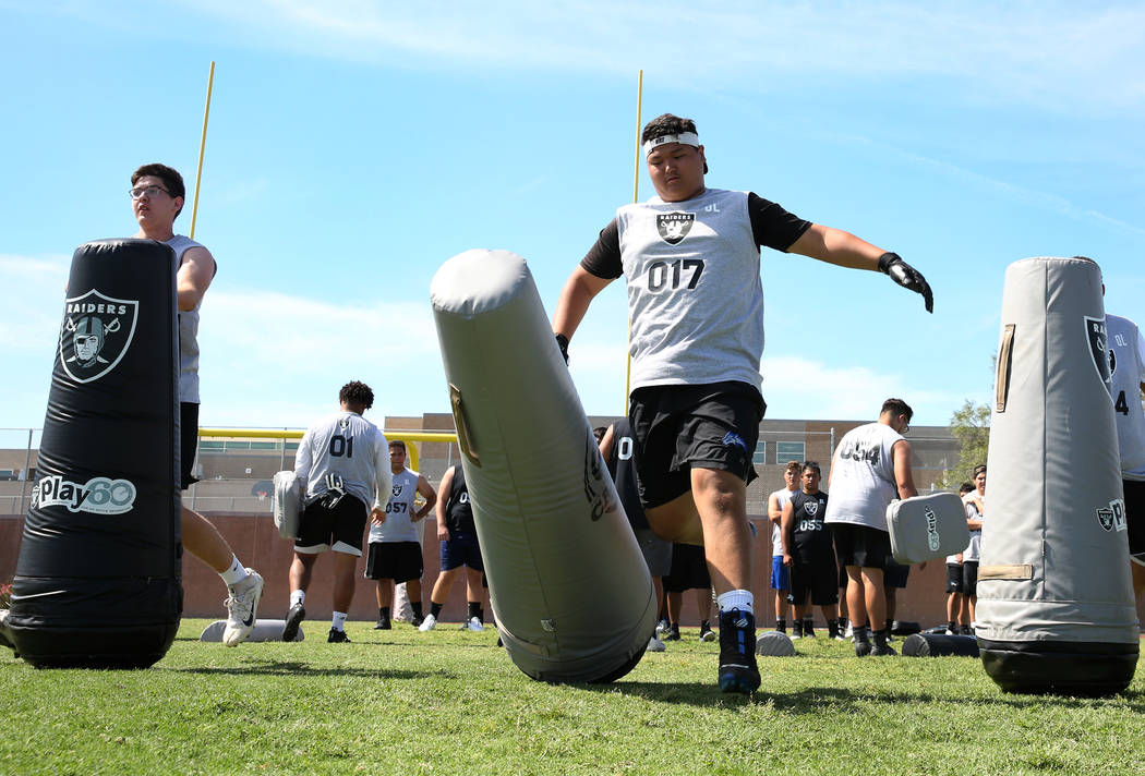 Henry Lim, right, Basic High's offensive guard, hits a bag as local Clark County area high scho ...