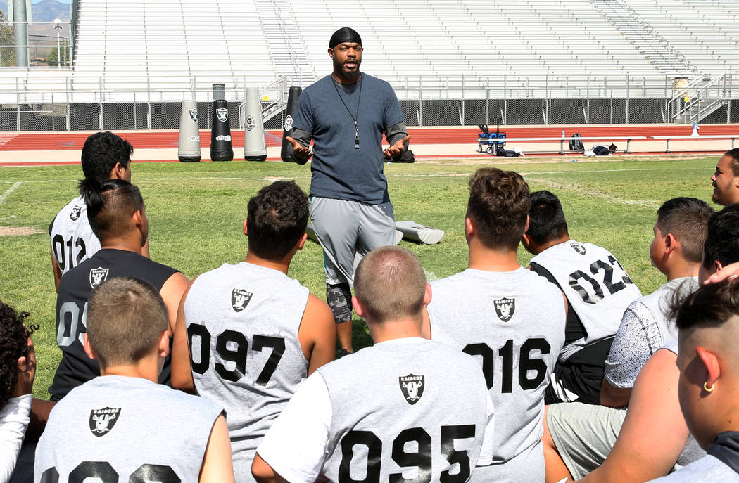 Dejuan Peterson of Freedom Classical Academy speaks to Clark County-area high school football p ...