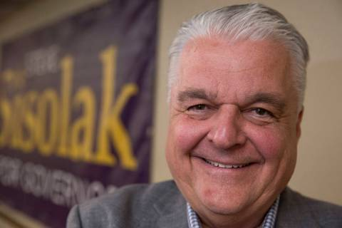 Clark County Commission Chairman and Democratic gubernatorial candidate Steve Sisolak poses aft ...