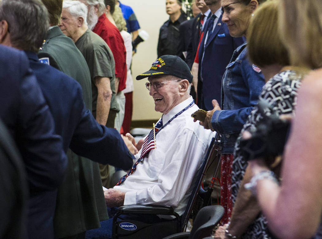 World War II veteran William Dunsmore reacts after leading the Pledge of Allegiance during a ce ...