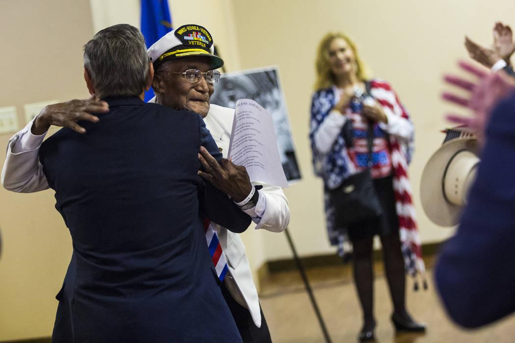 Elks Lodge official Bob Reed, left, hugs World War II, Korea and Vietnam veteran Arby Hambric, ...