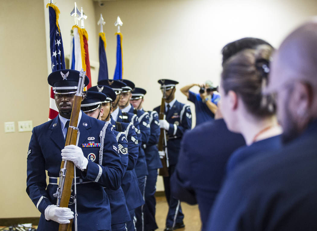 Members of the Nellis Air Force Base Honor Guard are seen at the start of a ceremony commemorat ...