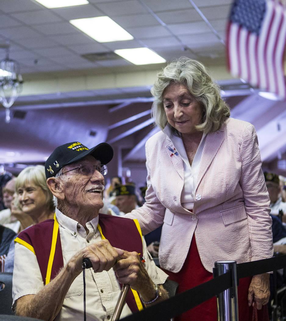 World War II veteran Dean Whitaker, 94, left, talks with U.S. Rep. Dina Titus, D-Nev., before t ...