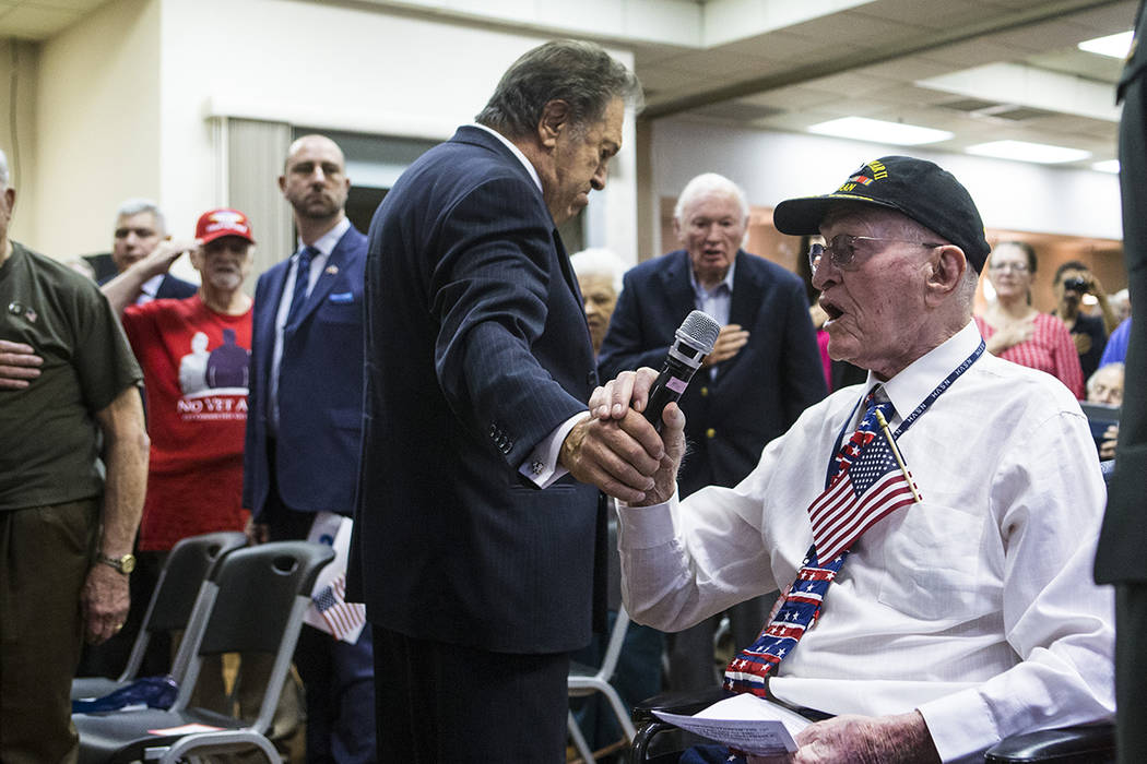 World War II veteran William Dunsmore leads the Pledge of Allegiance during a ceremony commemor ...