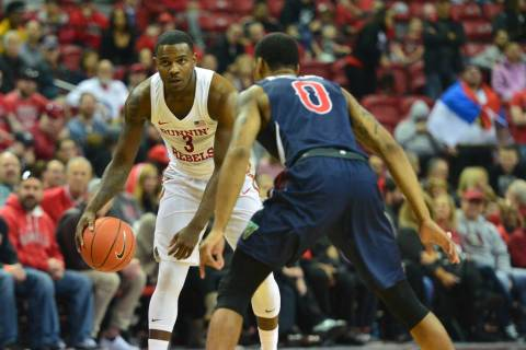 UNLV Rebels guard Amauri Hardy (3) starts a play while being guarded by Fresno State Bulldogs g ...