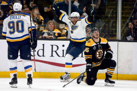 St. Louis Blues' David Perron, center, celebrates his goal behind Boston Bruins' Noel Acciari, ...