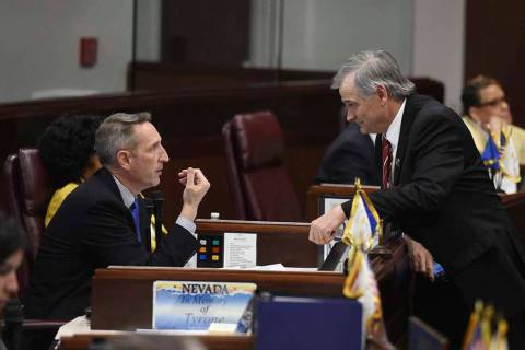 Nevada State Senators Scott Hammond, left, and James Settelmeyer chat during a break on the Sen ...