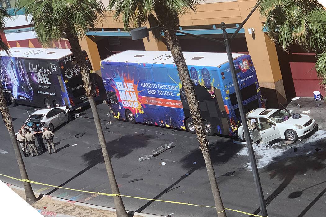Police investigate a crash on Las Vegas Boulevard near Fremont Street in downtown Las Vegas on ...