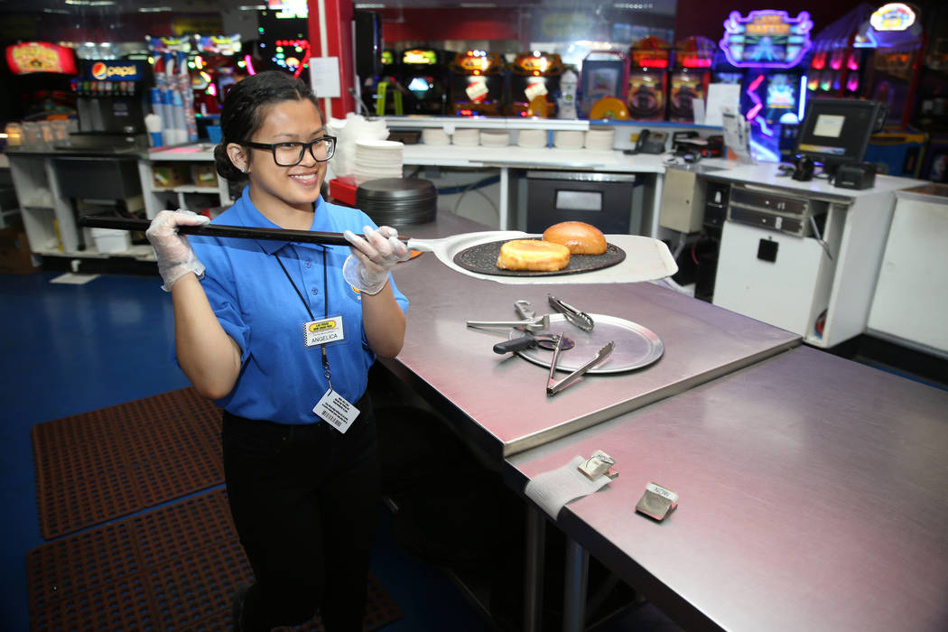 Canyon Springs High School graduate Angelica Tariman, 17, works in the kitchen at the Las Vegas ...