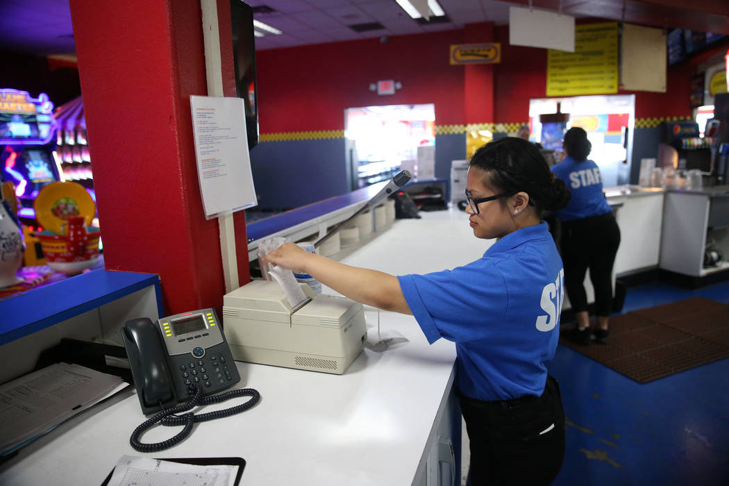 Canyon Springs High School graduate Angelica Tariman, 17, looks at a food order at the Las Vega ...