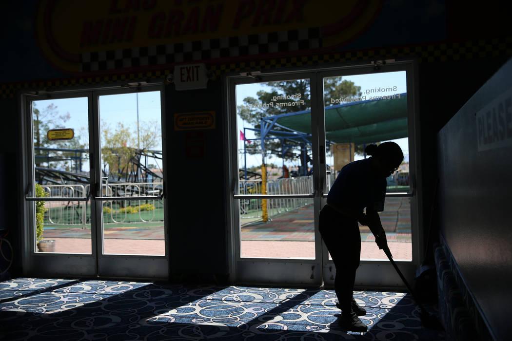 Canyon Springs High School graduate Angelica Tariman, 17, sweeps the floor at the Las Vegas Min ...