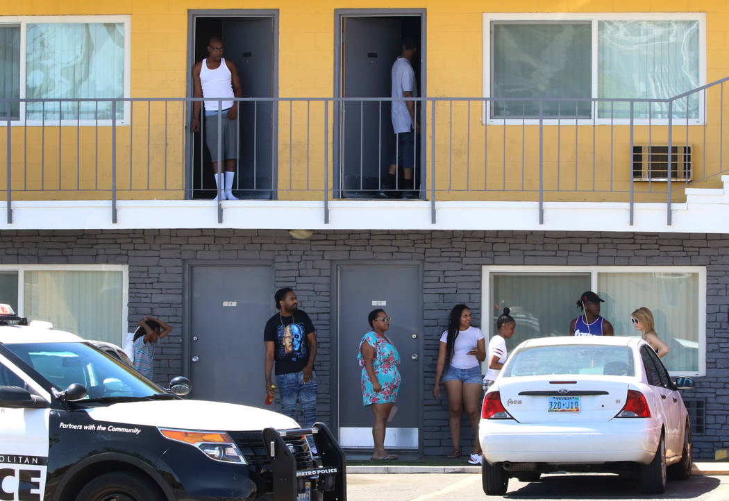 Residents at Siegel Suites watch as Las Vegas police investigate a bomb threat at 455 E. Twain ...