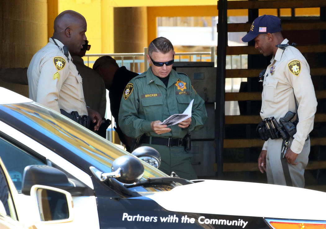 Las Vegas police investigate a bomb threat at a Siegel Suites at 455 E. Twain Ave., Friday, Jun ...
