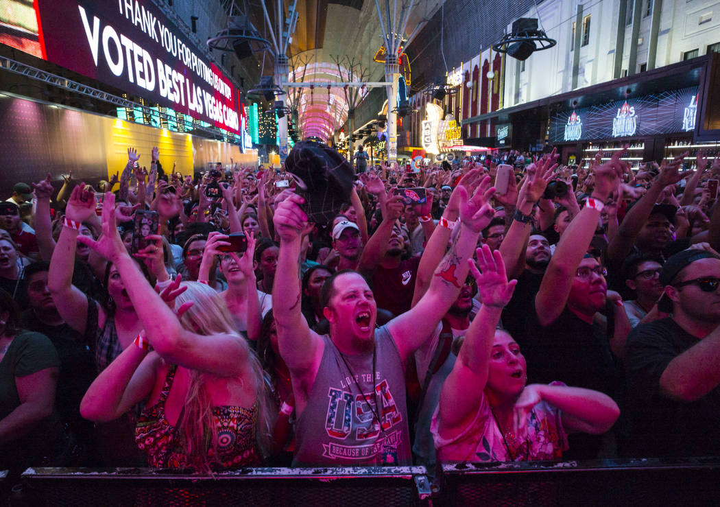 Fans cheer as Steve Aoki performs on the Main Street Stage at the Fremont Street Experience aft ...