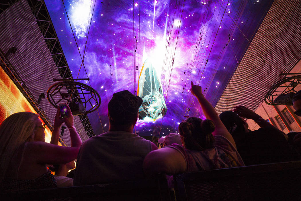 Fans watch the Steve Aoki Viva Vision light show at the Fremont Street Experience in downtown L ...