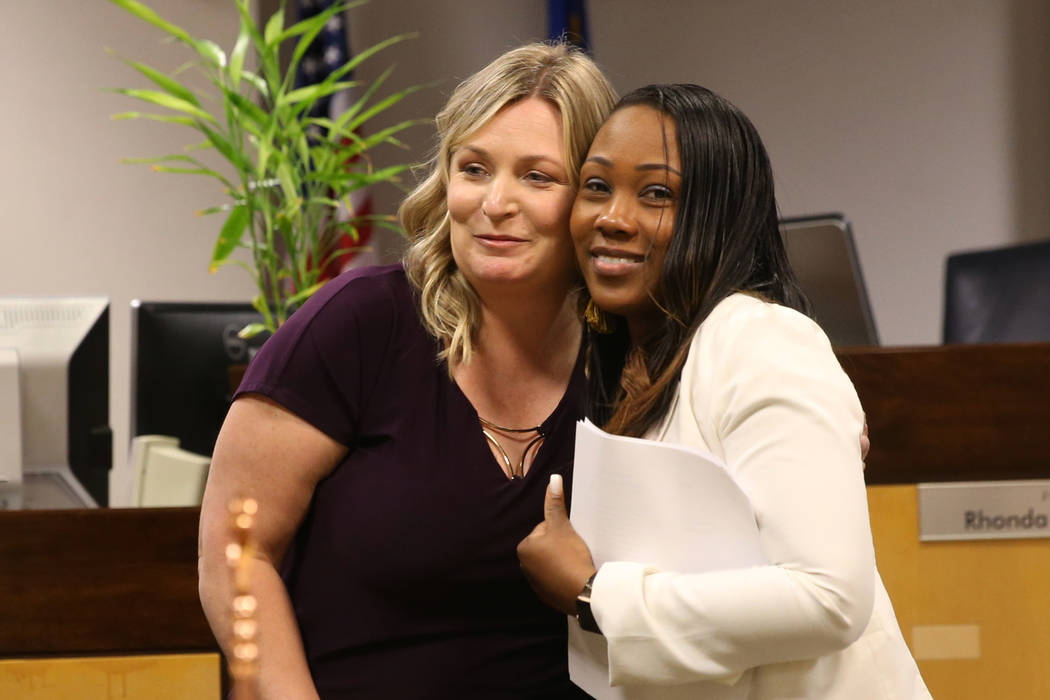 Family Advocate Breauna Trotter, right, with Sheila Scott, senior office specialist, is recogni ...