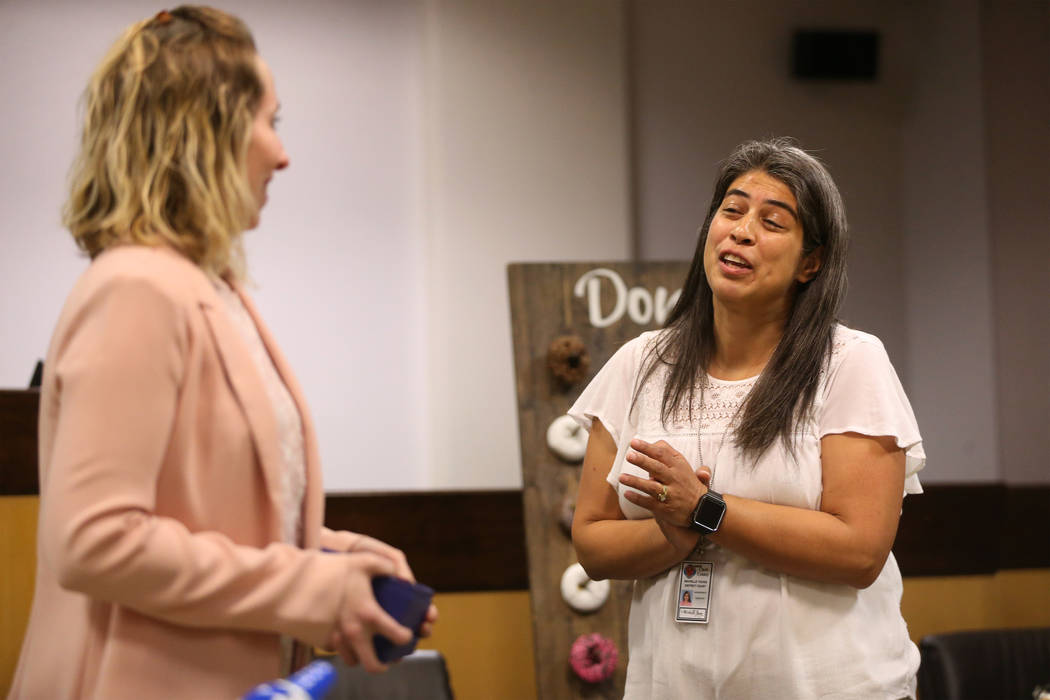 Jennifer Mtatabikwa-Walker, left, introduces Family Advocate Michelle Young, during the Truancy ...