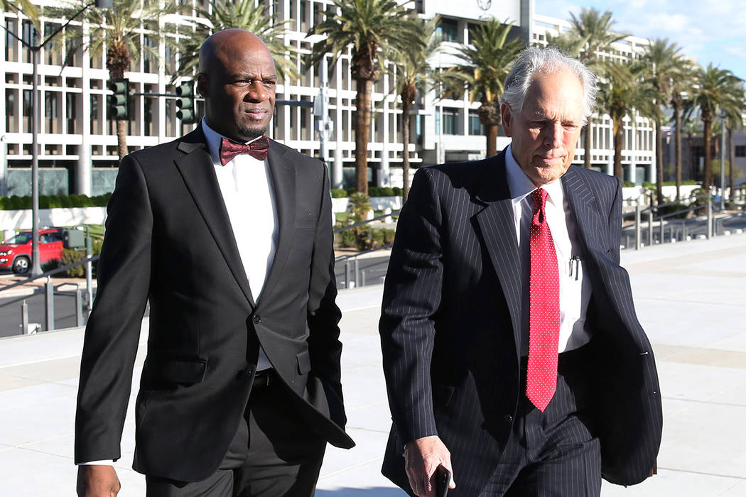 Former Nevada Senate majority leader Kelvin Atkinson, left, and his attorney Richard Wright arr ...