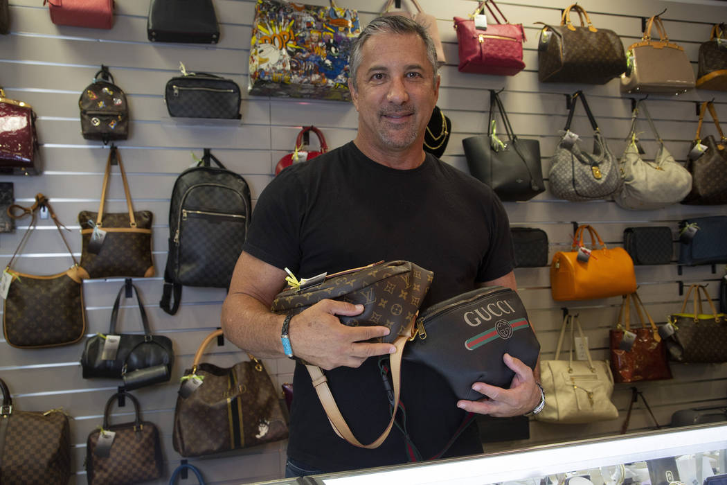 Michael Mack stands in front of luxury purses at Max Pawn in Las Vegas, Thursday, June 6, 2019. ...