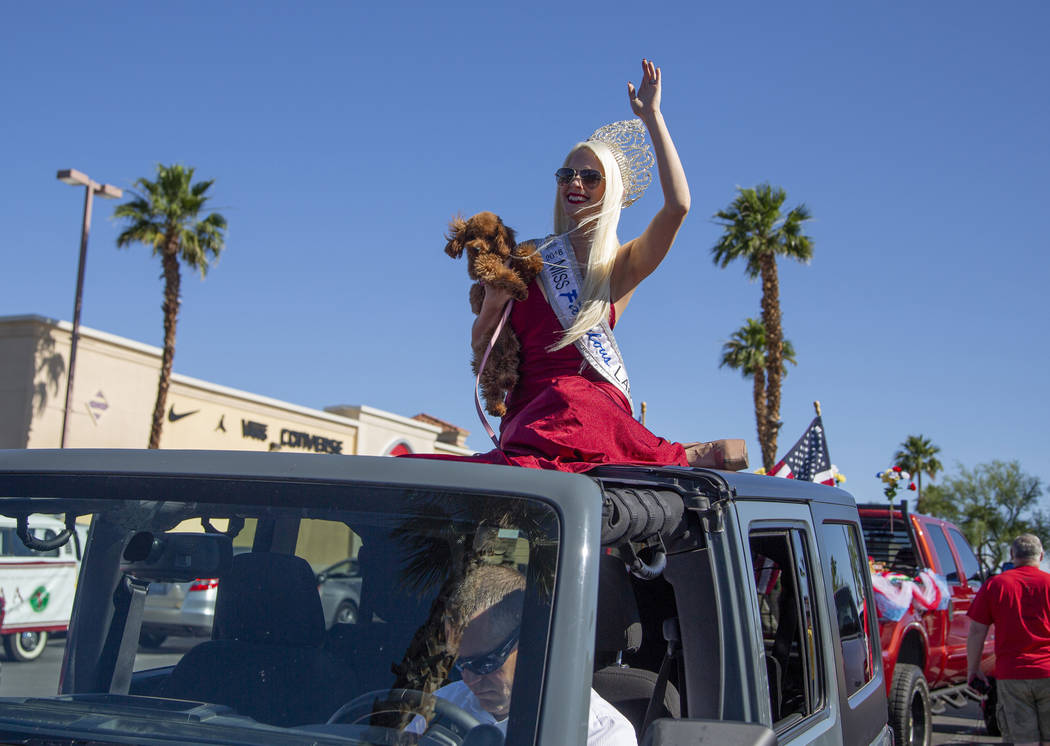 Kendra Daniels, 29, from Boston, waves before the parade during the fourth annual celebration o ...