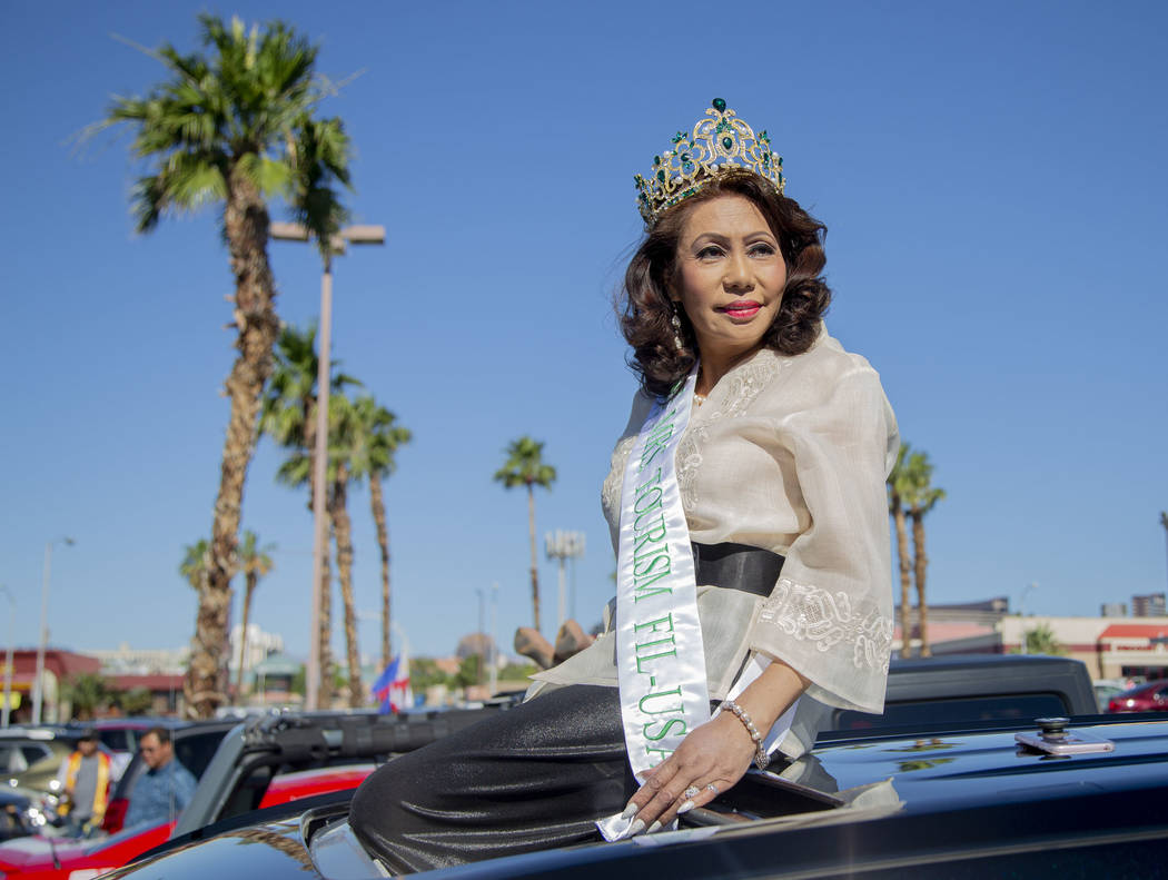 Ellen Stokes, from the Philippines, waits to drive off to the parade during the fourth annual c ...