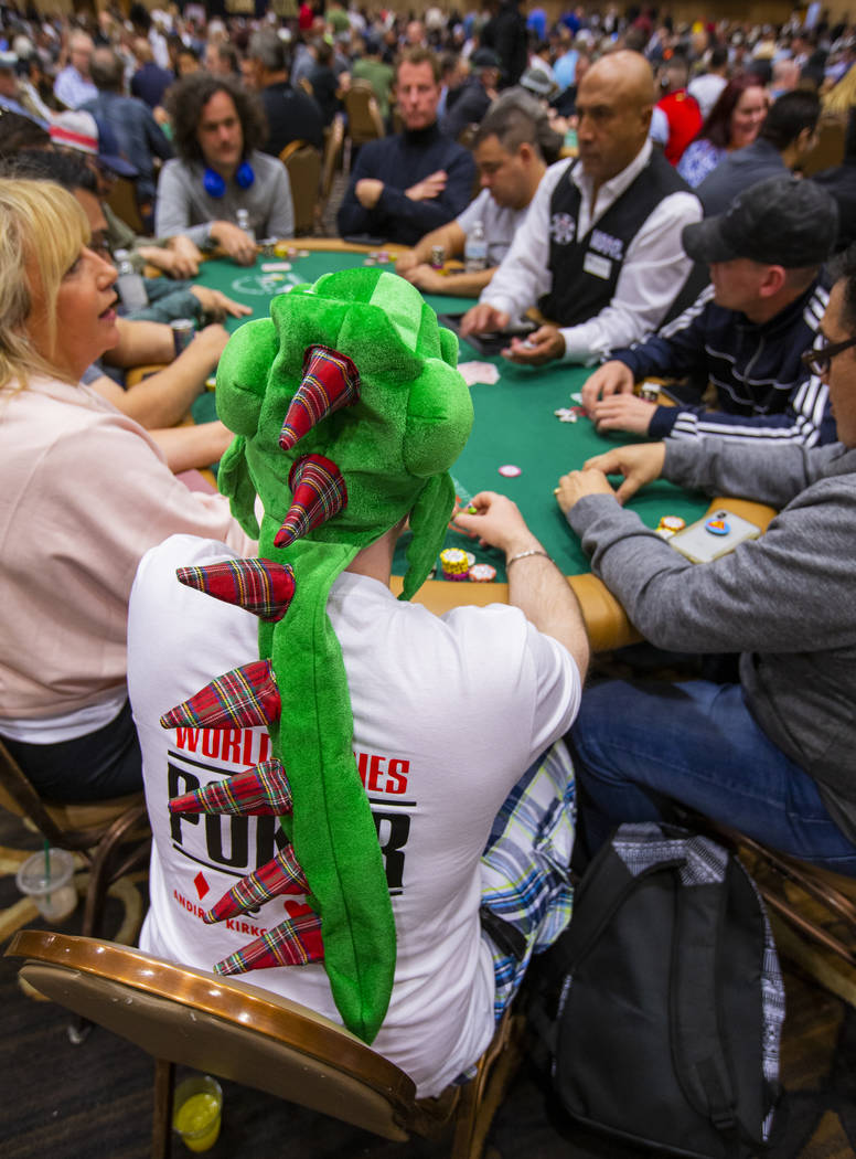 """Ian """"Aces"""" Sweden, of Kirkcady, Scotland, wears a dragon hat during the The Big 50, a ..."""