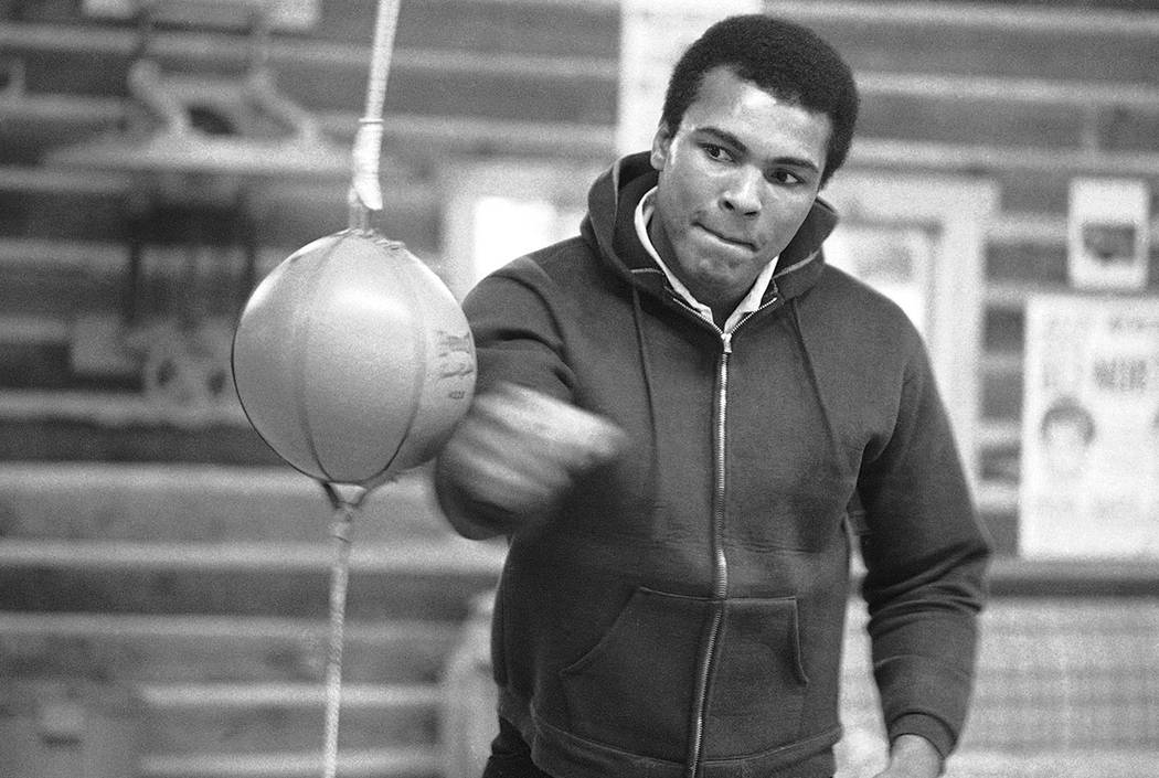 In this Jan. 10, 1974 file photo, Muhammad Ali punches a bag in his Deer Lake, Pa., training ca ...