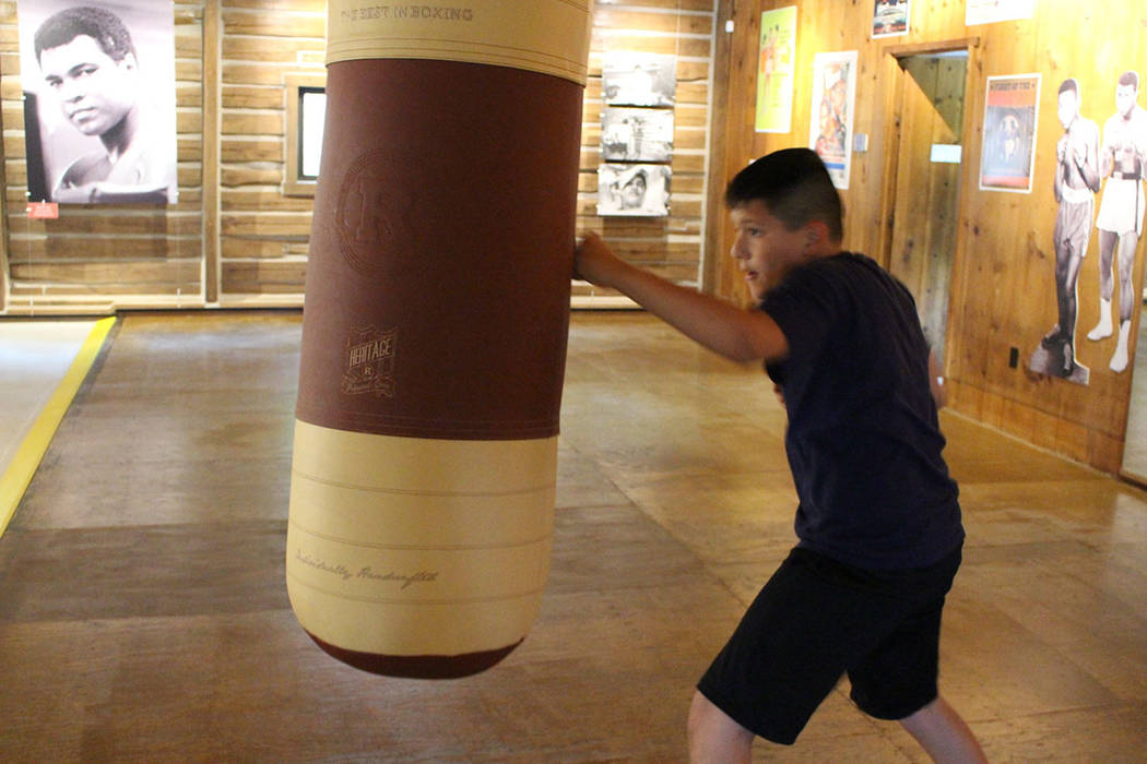 Benny Quiles-Rosa punches the heavy bag in the gym at Fighter's Heaven, Muhammad Ali&#x2 ...