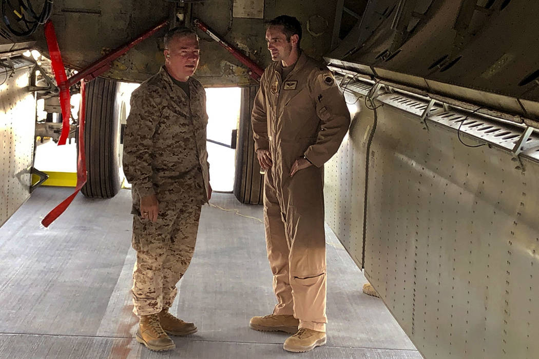 Marine Gen. Frank McKenzie, head of U.S. Central Command, confers with an Air Force officer bel ...