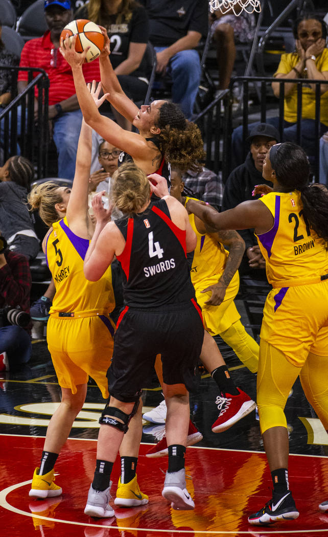 Las Vegas Aces forward Dearica Hamby (5) pulls down a rebound over Los Angeles Sparks guard Mar ...
